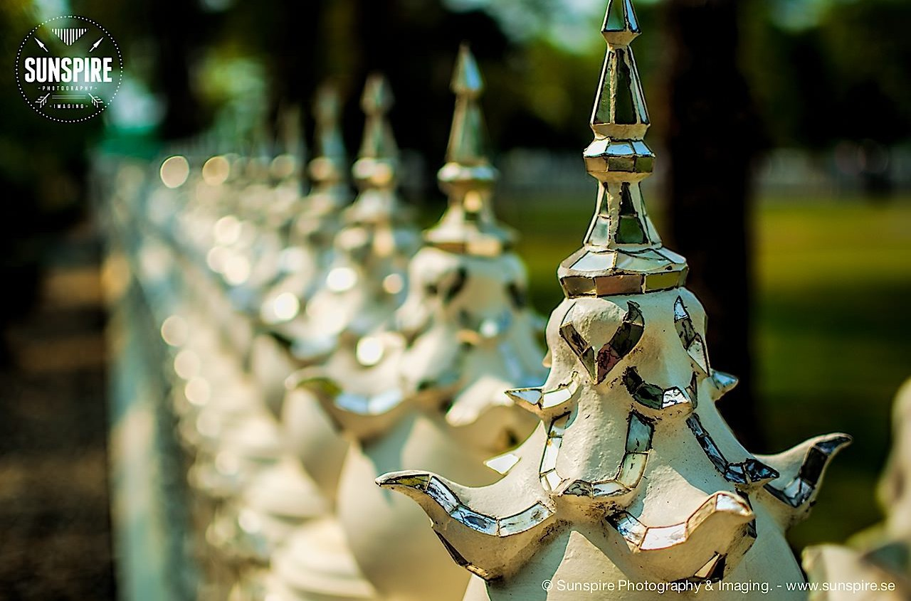 Bokeh photo of a fence surrounding Wat Rong Khun (White Temple), Chiang Rai, Thailand